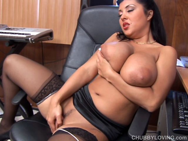 Chubby latina with amazing big boobs shows off sexy stockings and her wet pussy