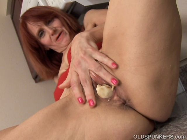 Skinny mature redhead has a food fetish in the kitchen