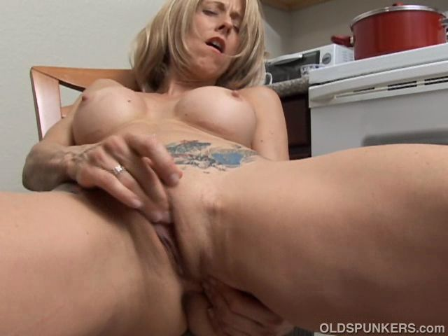 mature woman rubbing cunts with nipples