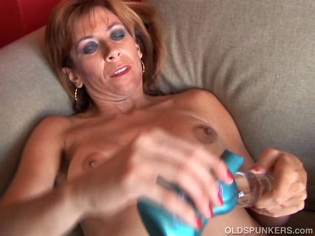 Mature redhead amateur with nice tits shows you how she loves to work her wet pussy